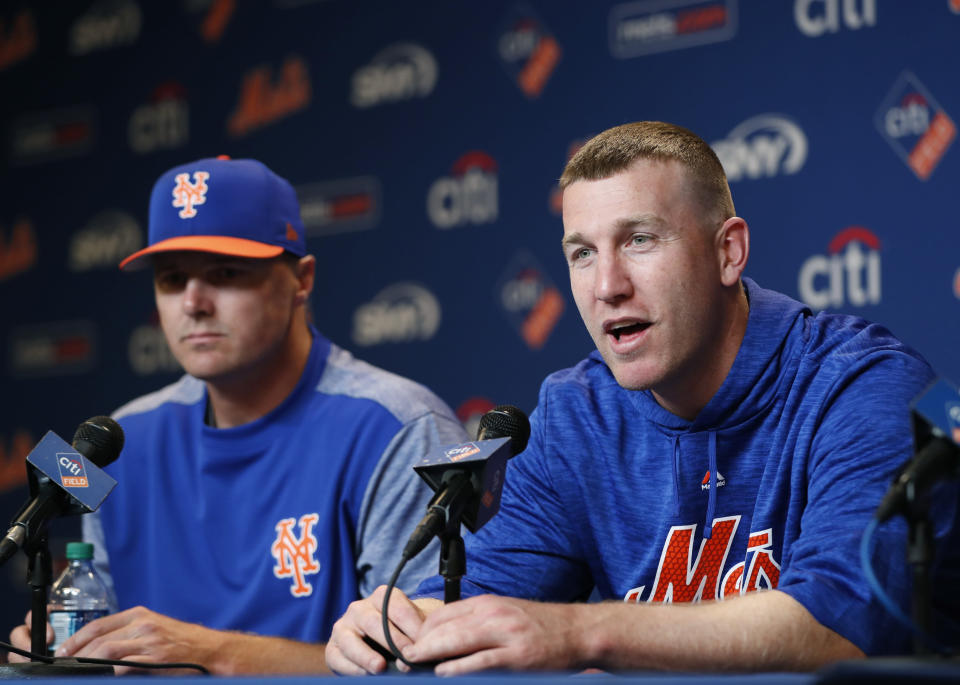 New York Mets Jay Bruce, left, listens as Todd Frazier, who was acquired during the off season from the New York Yankees, speaks during a news conference at Citi Field, Wednesday, March 28, 2018, in New York. (AP Photo/Kathy Willens)
