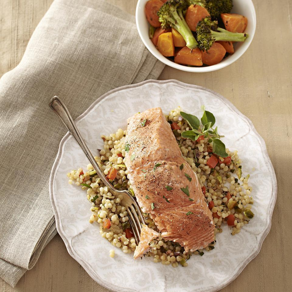 "<p>You need only one skillet for this meal of wild salmon fillets and Israeli couscous pilaf. For added fiber, look for Israeli couscous made with whole-wheat flour. Serve with roasted carrots and broccoli with cumin. <a href=""http://www.eatingwell.com/recipe/250599/salmon-with-toasted-israeli-couscous/"" rel=""nofollow noopener"" target=""_blank"" data-ylk=""slk:View recipe"" class=""link rapid-noclick-resp""> View recipe </a></p>"