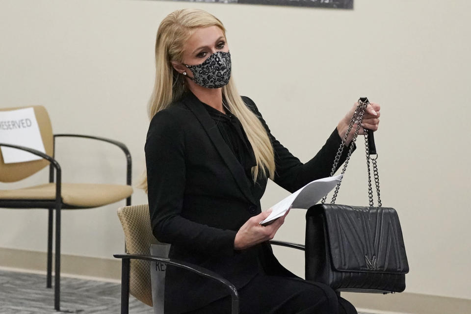 Paris Hilton looks on before speaking at a committee hearing at the Utah State Capitol, Monday, Feb. 8, 2021, in Salt Lake City. Hilton has been speaking out about abuse she says she suffered at a boarding school in Utah in the 1990s and she testified in front of state lawmakers weighing new regulations for the industry. (AP Photo/Rick Bowmer)