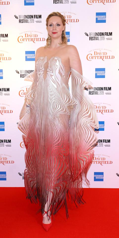 <p>Gwendoline Christie attended the BFI London Film Festival in a whimsical Iris Van Herpen gown and criss-cross strap heels.</p>