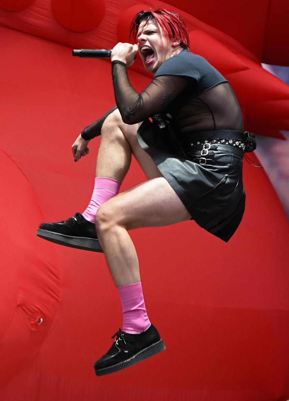 <p>Yungblud reaches for the sky during day one of the Leeds Festival at Bramham Park in England on Aug. 27.</p>