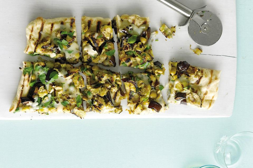 """Pile a few choice toppings on store-bought pizza crust and throw it on the grill for a magnificent—and easy—vegetarian dinner. <a href=""""https://www.epicurious.com/recipes/food/views/eggplant-green-olive-and-provolone-pizza-354498?mbid=synd_yahoo_rss"""" rel=""""nofollow noopener"""" target=""""_blank"""" data-ylk=""""slk:See recipe."""" class=""""link rapid-noclick-resp"""">See recipe.</a>"""