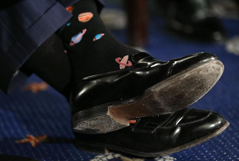 The socks of former NASA astronaut Buzz Aldrin are shown as he testifies before the Senate Space, Science, and Competitiveness Subcommittee on Capitol Hill on Feb. 24, 2015.
