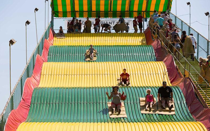The Giant Slide is just one of the many attractions at the State Fair. Attendees (and some Presidential candidates, too) hop on a potato sack and slide down the wavy apparatus in a short but thrilling ride. | Jason Bergman