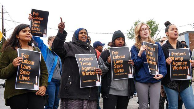 Demonstrators rally outside Fiera Foods in North York, Ont. after temporary worker Enrico Miranda died on the job.