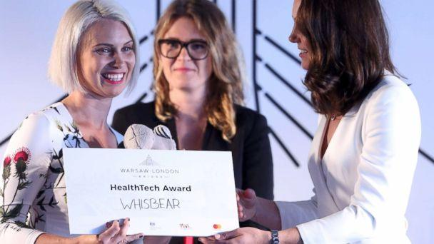 PHOTO: Britain's Catherine, Duchess of Cambridge awards Zuzanna Sielicka-Kalczynska from the Whisbear The Humming Bear company with the Health Tech Award at the Heart business incubator in the Warsaw Spire building in Warsaw, Poland, July 17, 2017. (Leszek Szymanski/EPA)