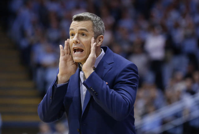 Virginia head coach Tony Bennett directs his players during the first half of an NCAA college basketball game against North Carolina in Chapel Hill, N.C., Monday, Feb. 11, 2019. (AP Photo/Gerry Broome)