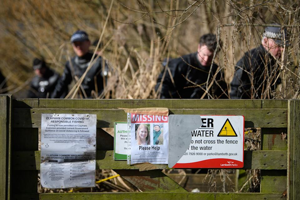 LONDON, ENGLAND - MARCH 09: A poster is seen as police search teams work their way through the reeds in Mount Pond on Clapham Common as the hunt for missing woman Sarah Everard enters its fifth day, on March 09, 2021 in London, England. Sarah Everard, 33, from Brixton, London has been missing since leaving a friend's home in Clapham on Wednesday, March 3. She was last seen at about 21.30 GMT, wearing a green rain jacket, navy blue trousers with a white diamond pattern, turquoise and orange trainers, a white beanie hat and possibly wearing green earphones. (Photo by Leon Neal/Getty Images)