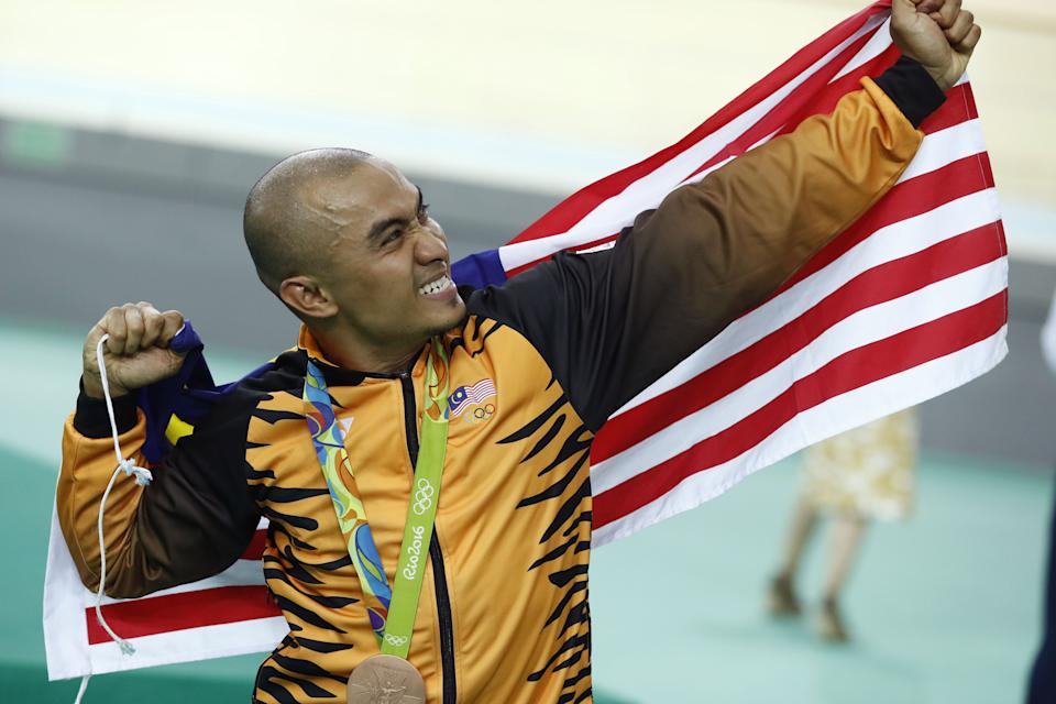Malaysia's Azizulhasni Awang poses on the podium after winning a bronze medal in the men's keirin cycling event at the 2016 Rio de Janeiro Olympics.