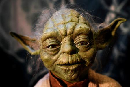 FILE PHOTO: The Yoda puppet used in the original movies, is seen at the Star Wars Identities exhibition at the 02 in London, Britain, November 8, 2016.  REUTERS/Dylan Martinez/File Photo