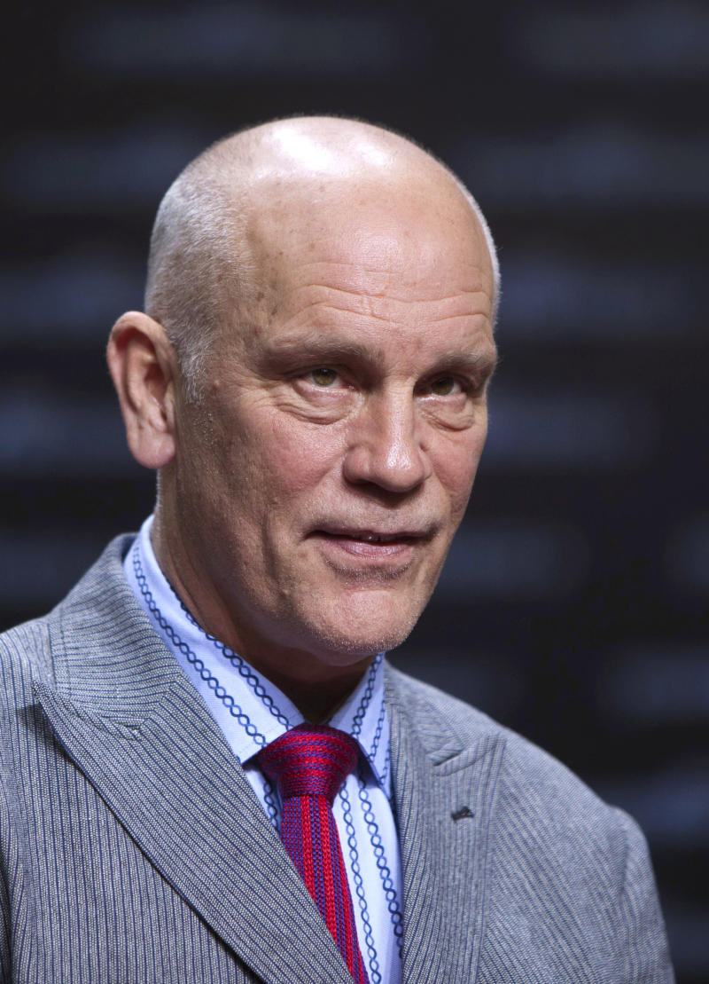 """FILE  -  In this Saturday, June 25, 2011 file photo actor John Malkovich attends the German premier of the movie Transformer 3 in Berlin. John Malkovich said Saturday Sept. 24, 2011 his latest acting role, an aging Siberian mobster trying to raise his grandson to be an honorable crook, proved to be a """"delightful"""" experience. The movie, """"Siberian Education,"""" is set in Trans-Dniester, now a separatist republic between Moldova and Ukraine, though filming of the U.S.-Italian production took place in Lithuania and wrapped up this week.  (AP Photo/Markus Schreiber)"""