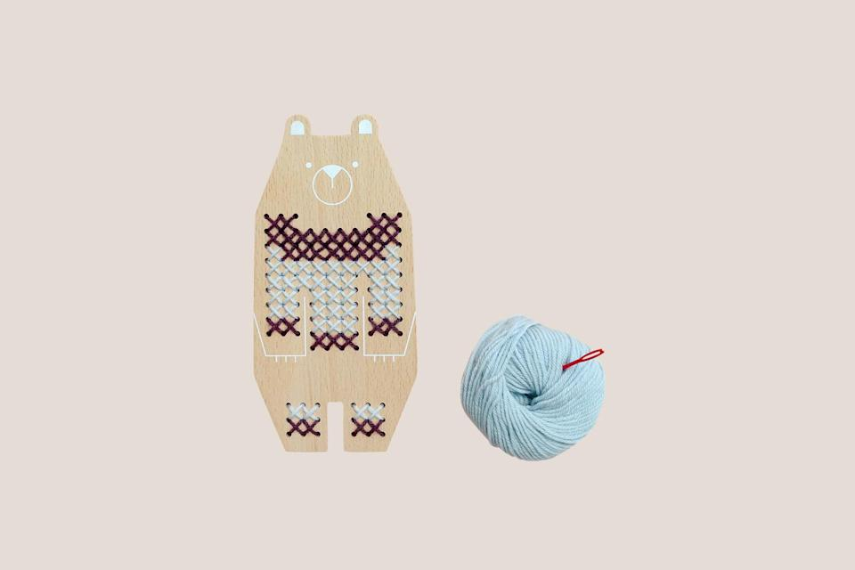"""<p>Cross-stitching is a fun craft activity for kids. Teach them the technique by stitching together a sweater for their animal friend, which comes with 100 percent wool yarn in two tones, a child-safe needle, and a play booklet.</p> <p><strong><em>Shop Now:</em></strong> <em>Moon Picnic """"Bear"""" Cross Stitch Friends, $21, </em><a href=""""https://moonpicnic.com/product/cross-stitch-friends-bear/"""" rel=""""nofollow noopener"""" target=""""_blank"""" data-ylk=""""slk:moonpicnic.com"""" class=""""link rapid-noclick-resp""""><em>moonpicnic.com</em></a><em>.</em></p>"""