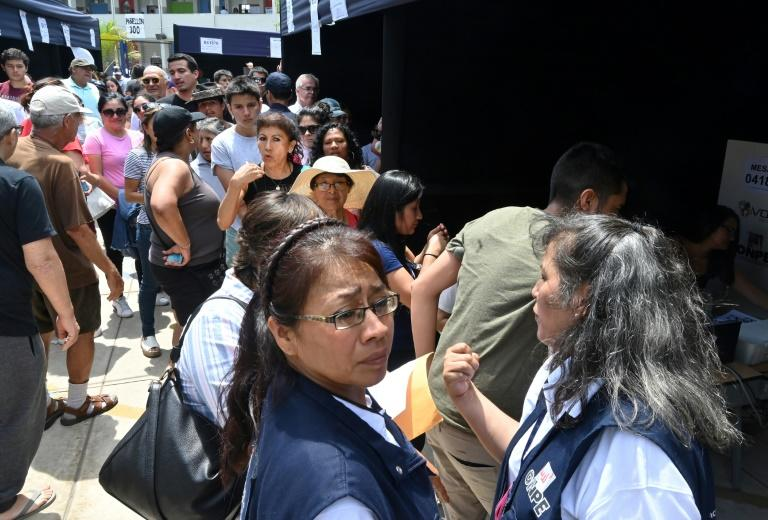 Voters queue at a polling station during legislative elections in Lima, on January 26, 2020