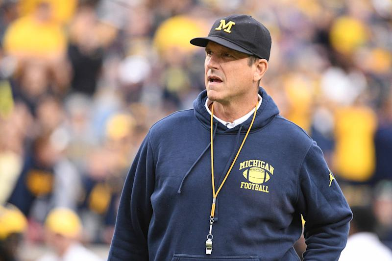 Michigan Wolverines head coach Jim Harbaugh might benefit from an extra coach on the sidelines. (USAT)