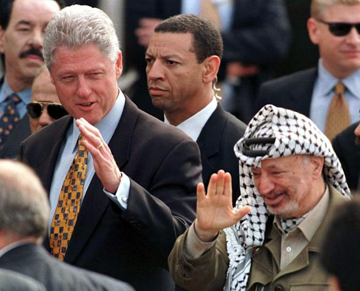FILE - In this Monday, Dec. 14, 1998 file photo, Secret Service agents guard U.S. President Bill Clinton and Palestinian leader Yasser Arafat at the Gaza International Airport at Rafah. The Secret Service has been tarnished by a prostitution scandal that erupted April 13, 2012 in Colombia involving 12 Secret Service agents, officers and supervisors and 12 more enlisted military personnel ahead of President Barack Obama's visit there for the Summit of the Americas. (AP Photo/Santiago Lyon)