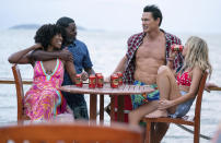 """This image released by Hulu shows Yvonne Orji, from left, Lil Rel Howery, John Cena and Meredith Hagner in a scene from """"Vacation Friends."""" (Jessica Miglio/20th Century Studios)"""