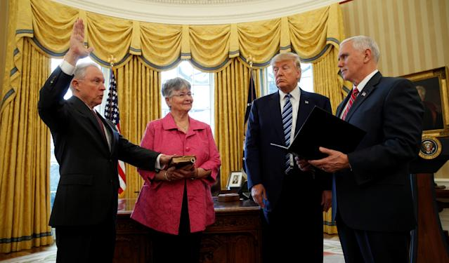 President Trump watches as Vice President Mike Pence, right, swears in Jeff Sessions as U.S. attorney general as Sessions's wife, Mary, holds a Bible in the Oval Office of the White House on Feb. 9, 2017. (Photo: Kevin Lamarque/Reuters)