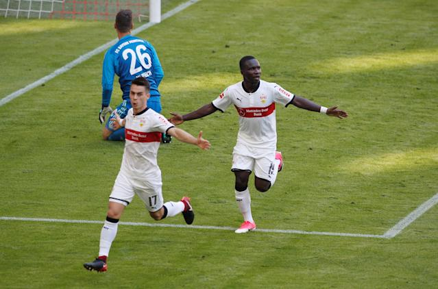 Soccer Football - Bundesliga - Bayern Munich v VfB Stuttgart - Allianz Arena, Munich, Germany - May 12, 2018 Stuttgart's Chadrac Akolo celebrates scoring their third goal with Erik Thommy REUTERS/Michaela Rehle DFL RULES TO LIMIT THE ONLINE USAGE DURING MATCH TIME TO 15 PICTURES PER GAME. IMAGE SEQUENCES TO SIMULATE VIDEO IS NOT ALLOWED AT ANY TIME. FOR FURTHER QUERIES PLEASE CONTACT DFL DIRECTLY AT + 49 69 650050