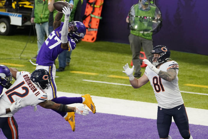 Minnesota Vikings cornerback Cameron Dantzler (27) intercepts a pass intended for Chicago Bears tight end J.P. Holtz (81) during the second half of an NFL football game, Sunday, Dec. 20, 2020, in Minneapolis. (AP Photo/Jim Mone)