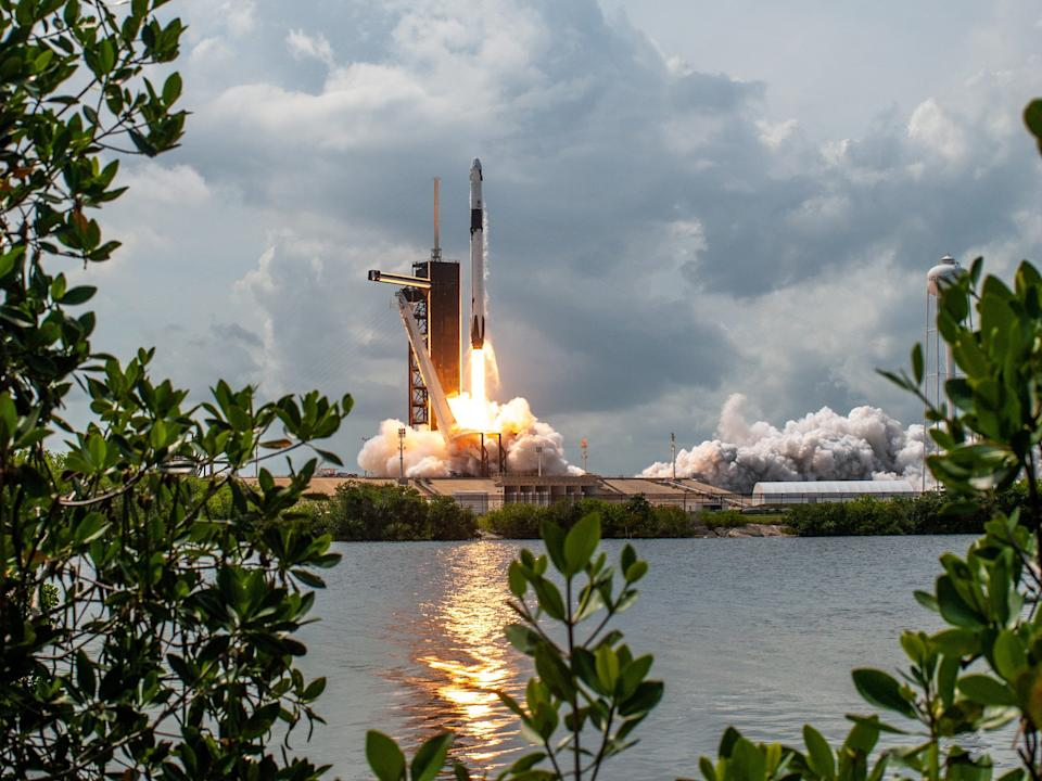 SpaceX's Demo-2 mission, launched with a Falcon 9 rocket, lifts off with Behnken and Hurley inside on May 30.