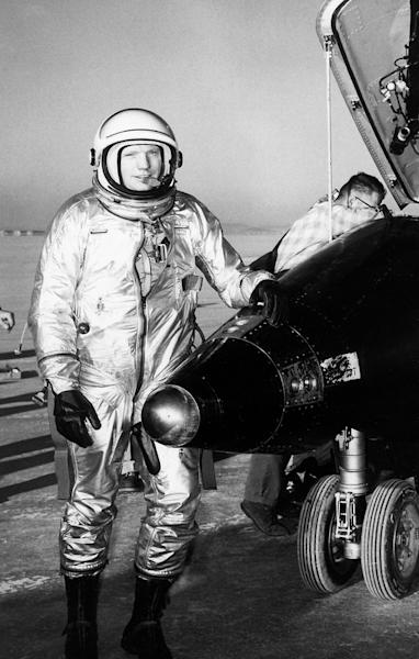 NASA test pilot Neil Armstrong is seen here next to the X-15 ship #1 after a research flight.