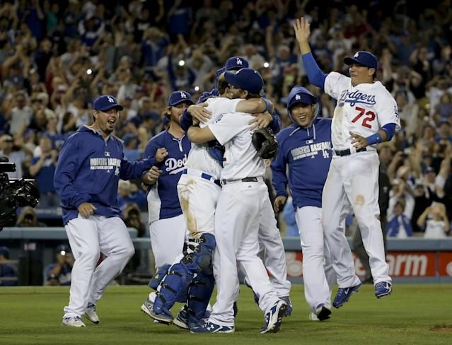 Los Angeles Dodgers starting pitcher Clayton Kershaw celebrates his no hitter with his teammates against the Colorado Rockies after a baseball game in Los Angeles, Wednesday, June 18, 2014. Kershaw struck out a career-high 15 batters. (AP Photo/Chris Carlson)