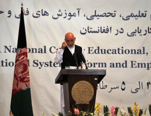 Afghan President Hamid Karzai addresses a seminar aimed at reforming Afghanistan's educational system in Kabul