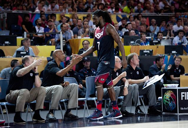 United States's Kenneth Faried, shakes hands with staff member during the Group C Basketball World Cup match against Turkey, in Bilbao, northern Spain, Sunday, Aug. 31, 2014. (AP Photo/Alvaro Barrientos)
