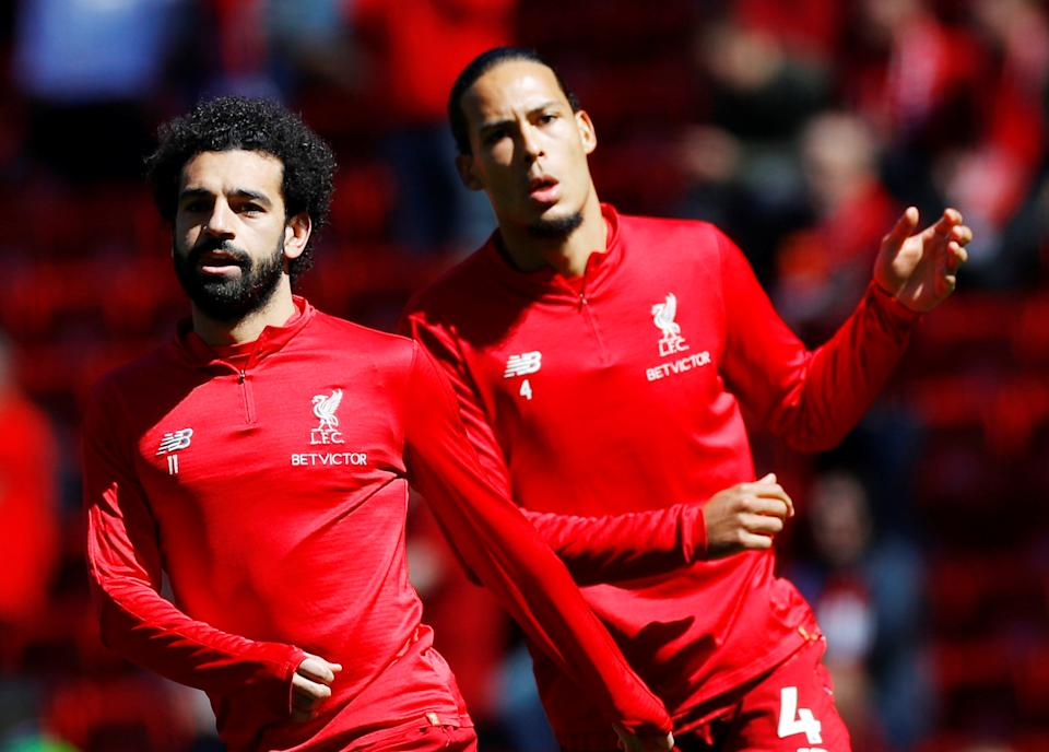 "Soccer Football - Premier League - Liverpool v Wolverhampton Wanderers - Anfield, Liverpool, Britain - May 12, 2019  Liverpool's Mohamed Salah and Virgil van Dijk during the warm up before the match REUTERS/Phil Noble  EDITORIAL USE ONLY. No use with unauthorized audio, video, data, fixture lists, club/league logos or ""live"" services. Online in-match use limited to 75 images, no video emulation. No use in betting, games or single club/league/player publications.  Please contact your account representative for further details."