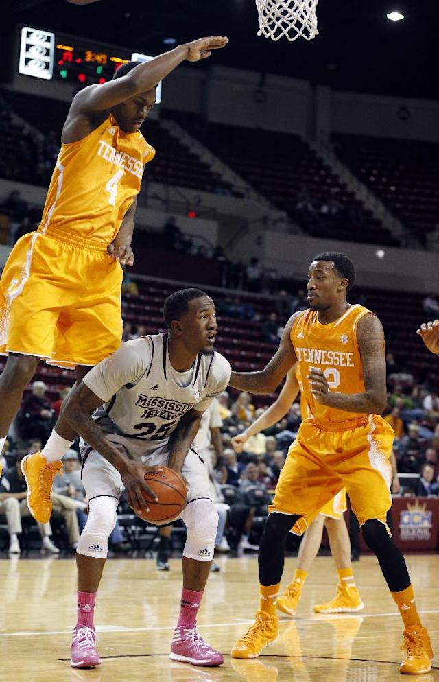 Mississippi State forward Roquez Johnson (25) looks for help as he is blocked by Tennessee guards Armani Moore (4) and Jordan McRae (52) in the first half of an NCAA college basketball game in Starkville, Miss., Wednesday, Feb. 26, 2014. (AP Photo/Rogelio V. Solis)