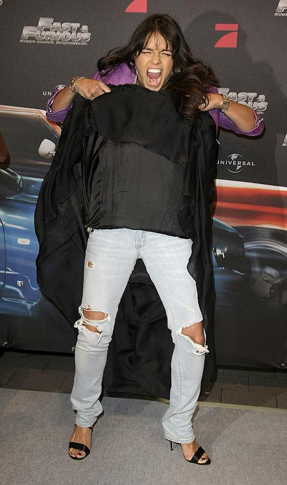 """It's fine if Michelle Rodriguez wanted to wear comfy jeans under her red carpet dress, but why did the """"Fast and Furious"""" star feel the need to show off her tattered trousers at the film's German premiere? Florian Seefried/<a href=""""http://www.gettyimages.com/"""" target=""""new"""">GettyImages.com</a> - March 17, 2009"""