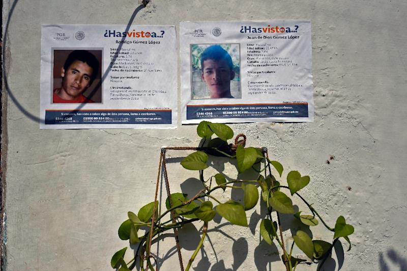 Posters show two of five youngsters who went missing on January 11, hang on the wall of the public prosecutor's office in Tierra Blanca community, Veracruz State, Mexico on January 26, 2016 (AFP Photo/Alfredo Estrella)