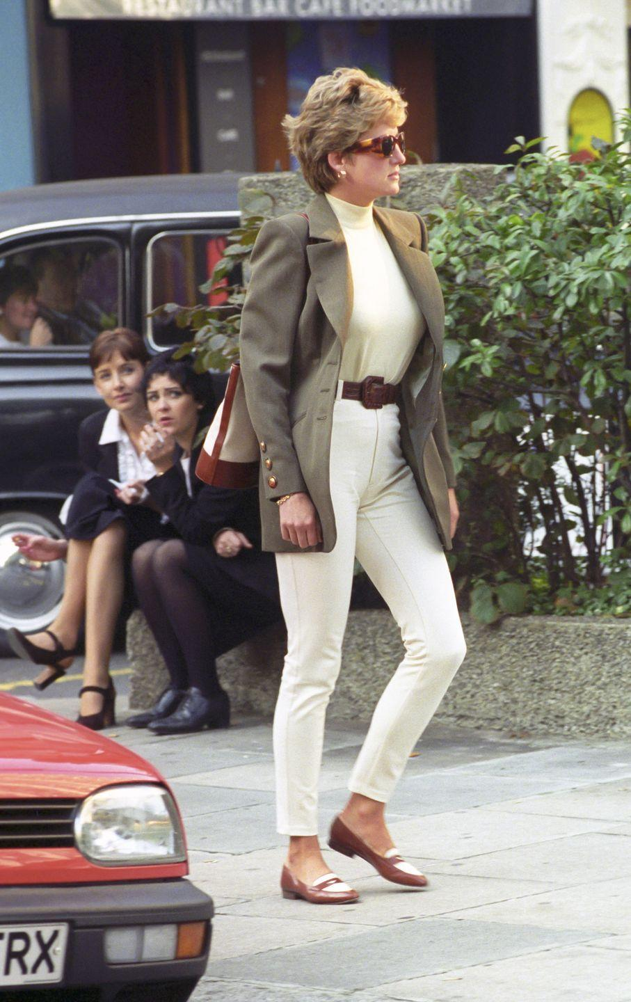 <p>Princess Diana was spotted shopping in Knightsbridge in 1994 wearing an ivory outfit with tan accessories, topped with an olive green blazer. </p>