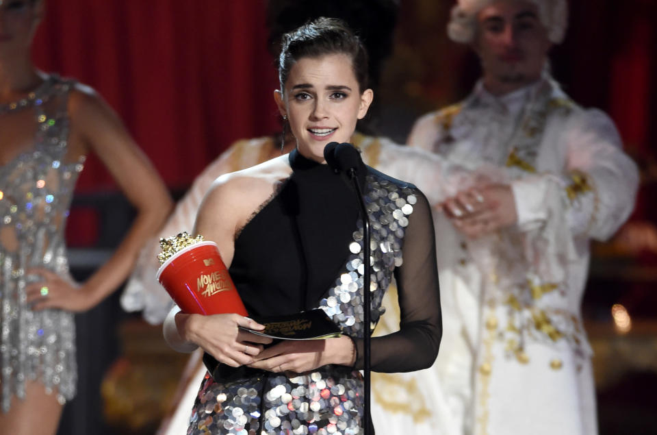 """Emma Watson accepts the award for best actor in a movie for """"Beauty and the Beast"""" at the MTV Movie and TV Awards in Los Angeles, 2017. (Photo: Chris Pizzello/Invision/AP)"""