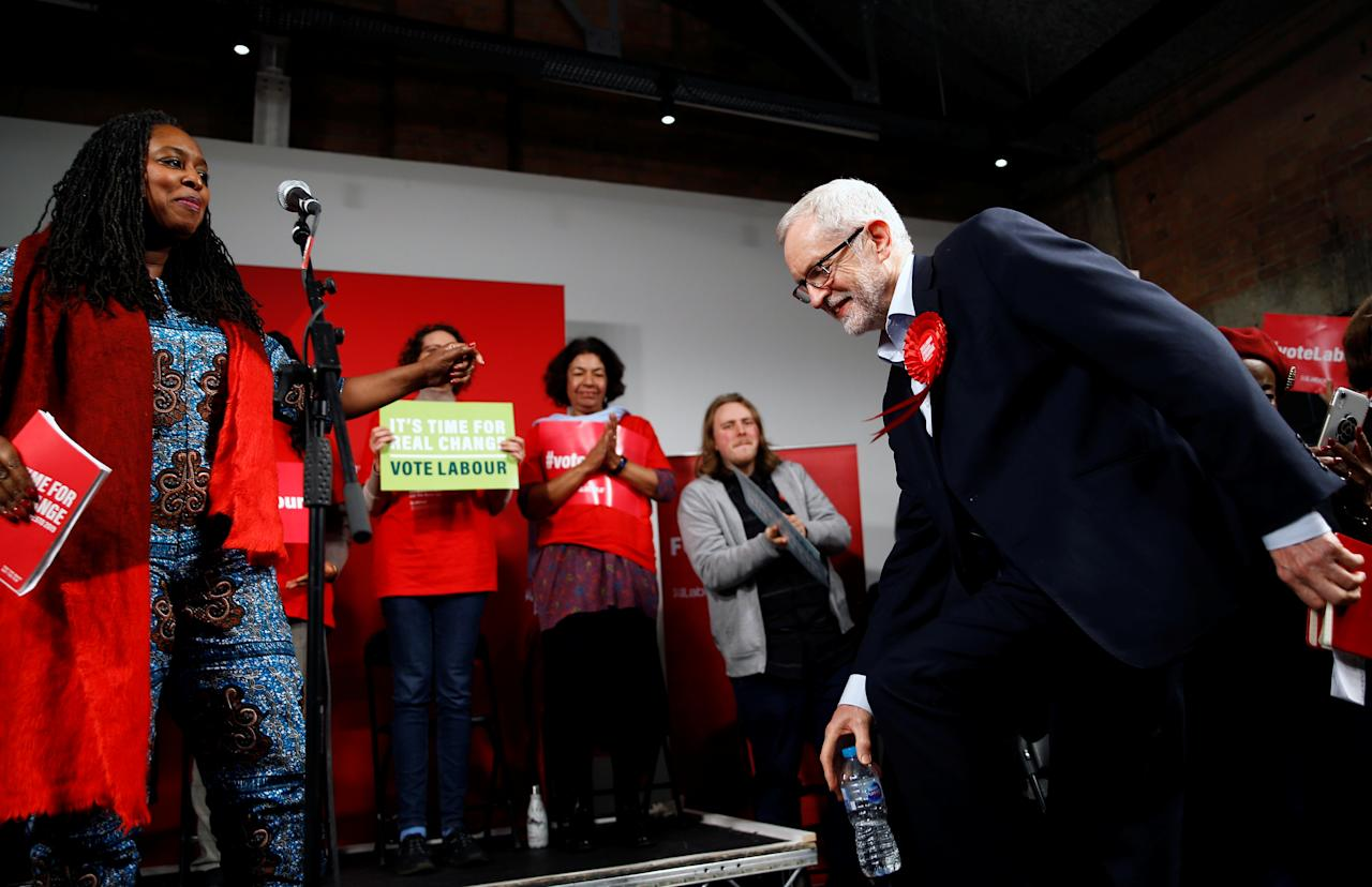 Britain's opposition Labour Party leader Jeremy Corbyn arrives as Britain's Labour Party's Women and Equalities Shadow Secretary Dawn Butler stands on the stage during a final general election campaign event in London, Britain, December 11, 2019. REUTERS/Henry Nicholls