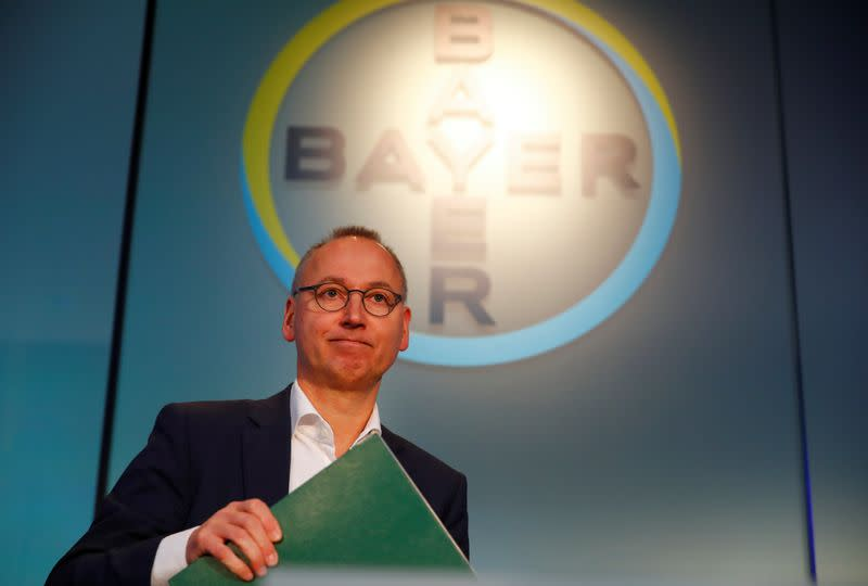 Werner Baumann, CEO of Bayer AG, arrives for the annual results news conference of the German drugmaker in Leverkusen