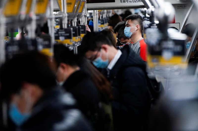 People wearing face masks are seen on a subway following an outbreak of the coronavirus disease (COVID-19) in Shanghai