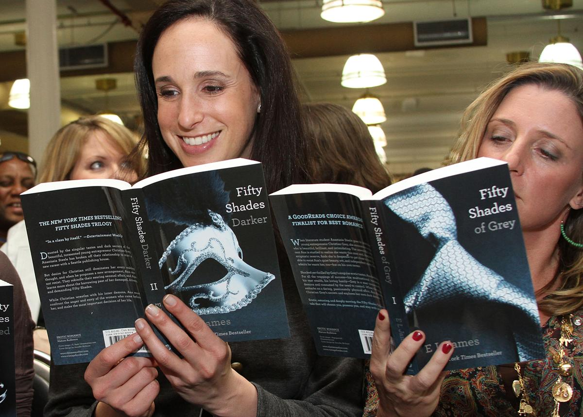 """Fifty Shades of Grey,"" the first book in a trilogy of ""Twilight""-inspired fan-fiction bondage erotica by E.L. James, became an underground reading obsession for millions of women in 2012. (Rob Kim/Getty Images)"