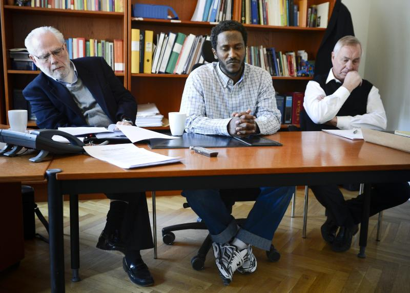 Yonas Fikre, center, a Portland, Oregon Muslim American talks to media with his U.S. attorney Thomas Nelson, left, and Swedish lawyer Hans Bredberg, right, in Stockholm, Sweden, April 18, 2012. After a 2010 trip to visit family in Khartoum, Sudan, Fikre claims to have been detained and tortured. Put on a FBI no-fly list, Fikre is now unable to return home to the U.S. (AP Photo / Claudio Bresciani)