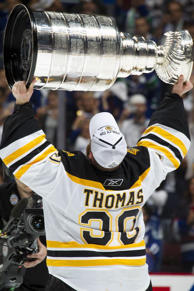 VANCOUVER, CANADA - JUNE 15: Tim Thomas #30 of the Boston Bruins celebrates with the Stanley Cup after winning Game Seven of 2011 NHL Stanley Cup Final against the Vancouver Canucks at Rogers Arena on June 15, 2011 in Vancouver, British Columbia, Canada. Boston won 4-0 to win the Stanley Cup. (Photo by Jeff Vinnick/NHLI via Getty Images)