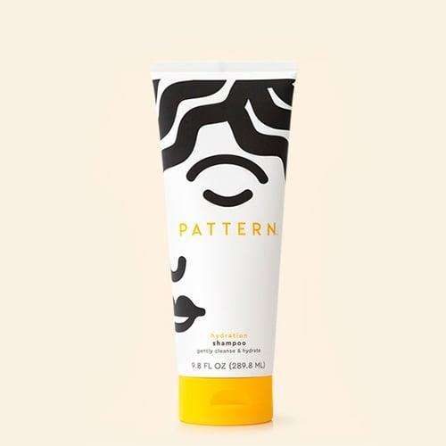 """<p>Our <a href=""""https://www.popsugar.com/beauty/tracee-ellis-ross-pattern-hair-products-review-46733354"""" class=""""link rapid-noclick-resp"""" rel=""""nofollow noopener"""" target=""""_blank"""" data-ylk=""""slk:editors can confirm"""">editors can confirm</a>: the <span>Pattern Beauty Hydration Shampoo</span> ($20) lives up to the hype. The formula features a blend of moisturizing ingredients like coconut oil and honey to gently cleanse the hair and remove buildup without being too stripping.</p>"""