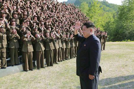 North Korean leader Kim Jong Un waves during an inspection at the commanding headquarters of the 264 Combined Forces, in this undated photo released by North Korea's Korean Central News Agency (KCNA) in Pyongyang on May 24, 2015. REUTERS/KCNA