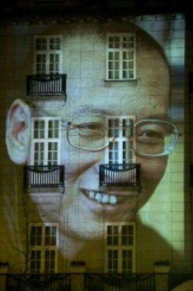Liu Xiaobo was unable to attend the 2010 ceremony when he was awarded the Nobel Peace Prize, but his face was projected on a hotel facade in Oslo