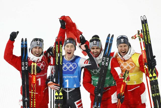 Nordic Combined Events - Pyeongchang 2018 Winter Olympics - Men's Team 4 x 5 km Final - Alpensia Cross-Country Skiing Centre - Pyeongchang, South Korea - February 22, 2018 - Bronze medallists Wilhelm Denifl, Lukas Klapfer, Bernhard Gruber and Mario Seidl of Austria celebrate REUTERS/Dominic Ebenbichler
