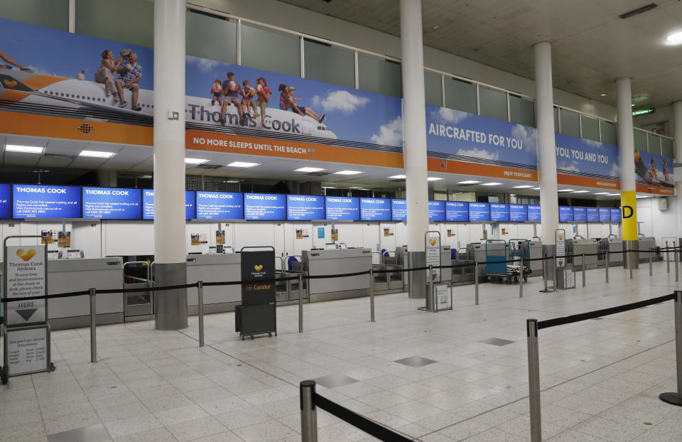 Empty Thomas Cook check-in desk in Gatwick Airport, England Monday, Sept. 23, 2019. British tour company Thomas Cook collapsed early Monday after failing to secure emergency funding, leaving tens of thousands of vacationers stranded abroad. (AP Photo/Alastair Grant)