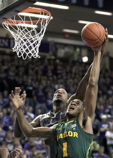 Kansas State center Jordan Henriquez, back, battles Baylor' Perry Jones III (1) for a rebound during the first half of an NCAA college basketball game, Tuesday, Jan. 10, 2012, in Manhattan, Kan. (AP Photo/Charlie Riedel)