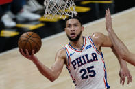FILE - Philadelphia 76ers guard Ben Simmons (25) goes to the basket during their NBA playoff basketball game against the Atlanta Hawks, in Atlanta, in this Saturday, June 12, 2021, file photo. Simmons says he's taking his ball and going home. The 76ers say they still want their disgruntled All-Star guard. (AP Photo/John Bazemore, File)