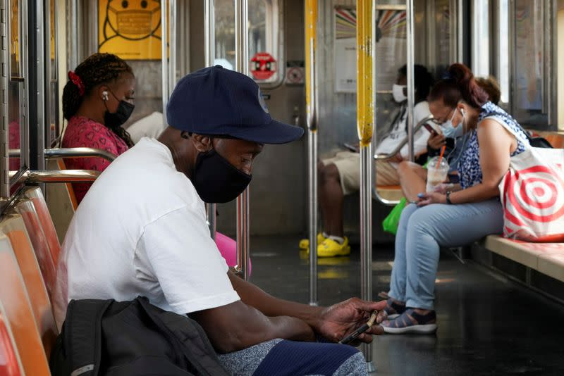 FILE PHOTO: People ride the subway in New York City