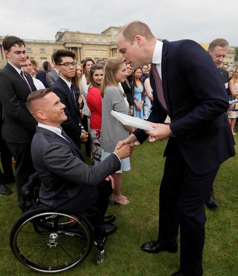 Britain's Prince William meets British Athlete David Weir during a day of DofE presentations at Buckingham Palace in London, Britain May 24, 2018. Kirsty Wigglesworth/Pool via REUTERS