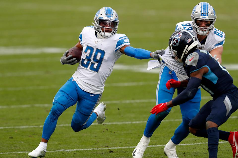 Wide receiver Jamal Agnew (39) of the Detroit Lions carries the football against the defense of the Tennessee Titans during the second quarter of the game Nissan Stadium on Dec. 20, 2020 in Nashville, Tennessee.